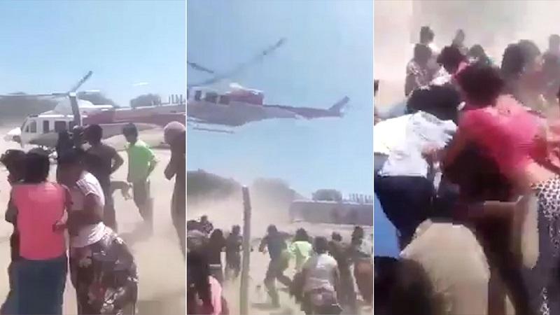 Un helicóptero deja comida y los vecinos